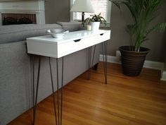 """29. #Console Table - Ikea #Hacks Anyone Can do ... Turn the """"Ekby Alex"""" shelf into a console with storage with the addition of some hairpin legs."""