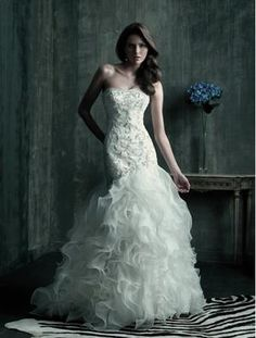 Wow! Lots of ruffles in this Allure Bridals C181 wedding dress  This type of silhouette but different ruffles