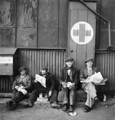 Beaton, Cecil -- Shipbuilding: Four shipyard workers eating their sandwich lunch in the dockyard. -- High quality art prints, canvases -- Imperial War Museum Prints