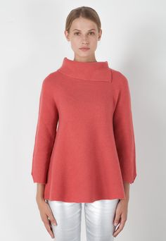 Pure virgin wool sweater. The soft, warm yarn is characterized by links stitching. Raised neck with side opening and long sleeves with vents. The A-line design is loose and flared at the hem.