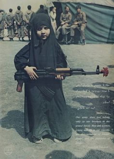young muslim girl with  army #auspol NOTE  Hope she keeps that gun and protect hereself and other girls.
