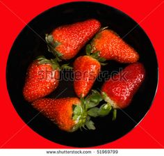 Fruits - Strawberries in a black bowl with water. Isolated on red background.#foodphotos #stockphotos #healthyfood #foodingredients #fruits #ItalianFood #Shutterstock #bio #naturalfood #eatingwell