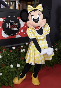 Minnie rocking her dots in her golden yellow polka dot outfit on National Polka Dot Day in Disney Springs