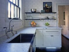 Black shelves add contrast & interest to a mostly white ktchen. If you want less, match wall color or use glass.  Simple Shelves - 15+ Design Ideas for Kitchens Without Upper Cabinets on HGTV