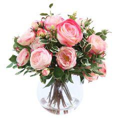 Faux pink rose arrangement in a glass vase.    Product: Faux floral arrangementConstruction Material: Silk and gl...