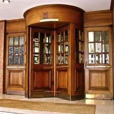 beautiful, solid mahogany revolving doors were salvaged from a hotel in Westminster, Central London.