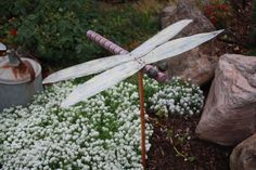 RUSTIC Utah Item # 37: Dragonfly garden art. Made from a spindle from an old crib. Purple dragonfly with corrugated metal wings.