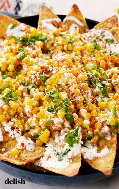 Street  corn nachos with corn chips.
