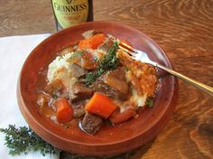 Irish Beef and Guinness Stew...close to what I make (I add mushrooms and serve over rosemary scented mashed potatoes).