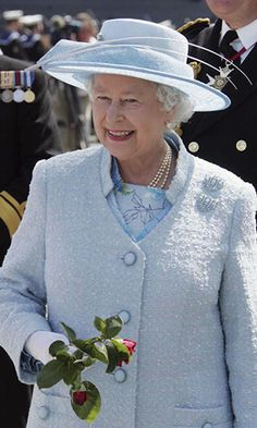 While paying a visit to troops, Queen Elizabeth has a moment in a sky blue hat that paired perfectly with her ensemble.