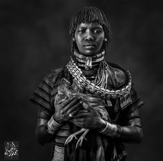 Woman from Omo Valley. Omo Valley is undoubtedly one of the most unique places on earth because of the wide variety of people and animals that inhabit it. It is located in Africa's Great Rift Valley. The region is known for its culture and diversity.