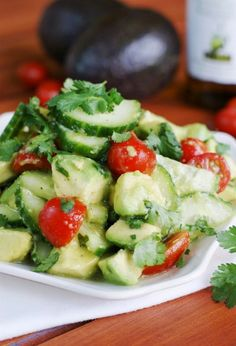 Simple Cucumber, Tomato, & Avocado Salad dressed with a light, flavorful citrus & honey vinaigrette Cucumber Recipes, Salad Recipes, Vegetarian Recipes, Cooking Recipes, Healthy Recipes, Avocado Tomato Salad, Cucumber Salad, Healthy Snacks, Healthy Eating