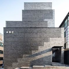 this building of black bricks was created without traditional mortar masonry. wise architecture used multiple layers of brick walls to create to create what they called an 'architectural mountain'. image by chin hyosook - see more korean #architecture on #designboom!