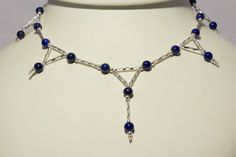 A lapis lazuli necklace with silver triangles