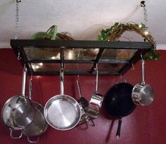 Add hooks to a vintage window frame then attach to ceiling with chains & you'll have a DIY hanging pot rack .