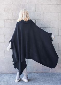 Invoke full drama in our poncho style cape made in a merino cashmere blend. Love this garment forever and submit to the encompassing coziness as it envelops you gently.  90% merino, 10% cashmere relaxed fit gentle hand wash, dry flat sizes available: SM, ML