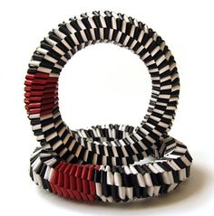 Bracelets | Francesca Vitali. Woven pages of books and magazines.