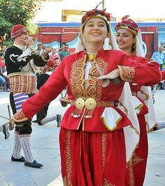 Folk dancers from Akşehir (Konya province), performing a local 'kaşık oyunu' (spoon dance; the wooden spoons are used as a kind of castanets).  The way they are holding the spoons is one out of two prevailing techniques; this technique is used by both men and women (the second, with the spoon held upward, is used by women only).