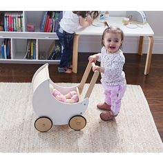 Wooden Moon Doll Pram $109.95 Every bubba girl needs a beautifully constructed wooden pram. WOODEN PRAM - WOODEN TOYS - ECO GIFTS FOR CHILDREN - NATURAL TOY - ECO TOYS
