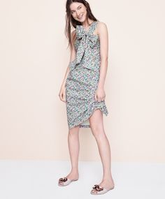J.Crew women's one-shoulder tie dress in Liberty® Claire-Aude floral and satin slides with floral embellishments.