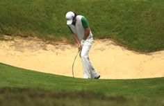 Golf Tips to Improve Your Wedge Play: Don't let this happen to you! Rory McIlroy angrily bends his sand wedge after a poor bunker shot. The wedge tips for chipping, pitching and bunker shots found on