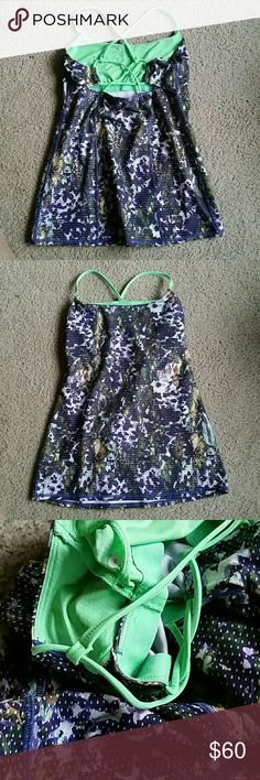 NEW! Lululemon Dancing Warrior Tank Sz 8 NEW ARRIVAL THIS WEEK! Lululemon athletica dancing warrior tank,  size 8. Strappy and cute, with built in bra and inserts for pads ( not included ). Its been worn but good condition overall. Luxtreme fabric. Just Selling bc it didnt fit. Make an offer! lululemon athletica Tops Tank Tops