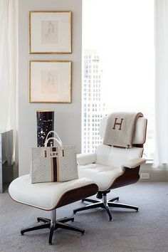 Eames lounge chair, Hermes avalon throw, Goyard bag