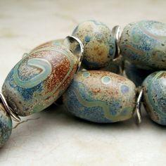 Handmade Lampwork Glass Bead Set,Rustic Organic Set of 11 in Blues, Green, Gray, Brown, Verde Argento. $70.00, via Etsy.