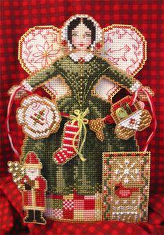 Brooke's Books Publishing Spirit Of Christmas Stitching Ornament Cross Stitch Pattern. Model stitched on 14ct. Metallic Gold Perforated Paper using DMC floss, K