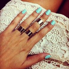 mid-finger rings bother me for some reason. &this nail color too.