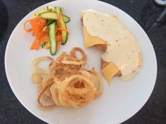 Chedder melt chicken  schnitzel with onion rings and veg salad