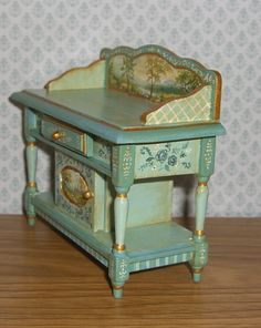 It is signed - Leslie Lassige (that's me!). and dated on the bottom of the piece. I've hand painted this little buffet in a base of seafoam green & french teal. Floral details in complementary blues decorate the sides and door. | eBay!