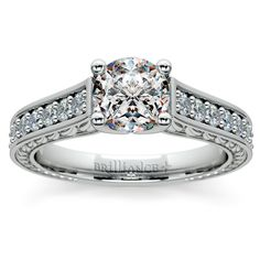 Antique Floral Diamond Engagement Ring in Platinum - Twenty eight graduated round cut diamonds are pave set in this exquisite antique floral diamond setting in platinum, accenting your choice of center diamond. Beautiful floral detailing adorns the inside band. Approximately 1/2 carat total diamond weight and proudly made in the USA.