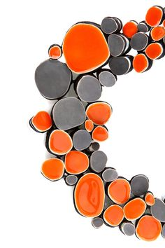Jasmin Winter | Silver, enamel. These colors and shapes draw me in.  I like contract and orange.