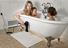 """Susan Copich, actress and a mother of two from New York, has taken a darkly humorous approach towards traditional family photography with a series of daring images entitled """"Domestic Bliss."""""""