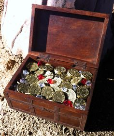 """Pirate Gold Poker Set - Metal poker chips with a antique gold finish. $275 gets you 250 metal coins, 125 """"Rubys"""", 125 """"Diamonds"""", Dealer Chip, Playing Cards (unnecessary, but okay), AND the wooden treasure chest. The whole thing weighs 15 pounds."""