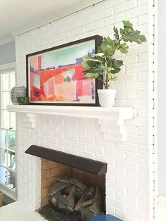 Consider painting your tired, dingy brick fireplace for a fresh, lighter living room look, suggests @emilyaclark. The fast DIY project totally transforms the lounge space's centerpiece!