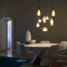 Harmonious combinations of shape and colors for Mom, the new collection of suspension lamps designed by Umberto Asnago for Penta.