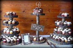 Rustic Wedding Cupcakes  ~The groom constructed the log cupcake trees with initials! 8 different specialty cupcake flavors