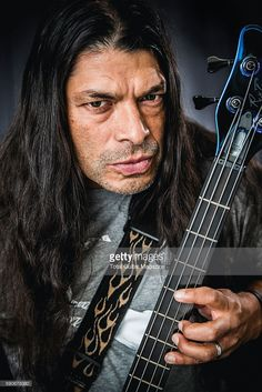 Portrait of American musician Robert Trujillo, bassist with heavy metal group Metallica, photographed backstage at Reading Festival in Berkshire, on August 29, 2015.