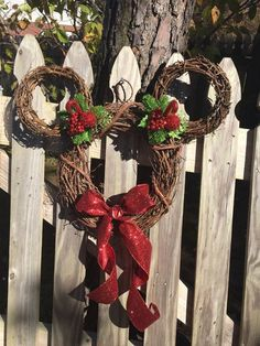 This festive Mickey mouse Christmas decoration can easily be recreated using a dollar store wreath as your base. Hang it outdoors for the neighbors to see or over your mantel for some good 'ol rustic charm. Mickey Mouse Wreath, Mickey Mouse Christmas, Noel Christmas, Christmas Garden, Mickey Mouse Crafts, Natural Christmas, Rustic Christmas, Handmade Christmas, Christmas Lights