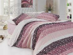Moderní povlečení z hladké bavlny doladí příjemnou a svěží atmosféru ve vaší ložnici.     Potisk povlaku na polštář je z obou stran stejný. Vzor na peřině kombinuje různé odstíny růžové na jedné straně, rubová strana je bílá se světlounce růžovými kolečky.     Zapínání je na zip.     Materiál: 100% hladká bavlna.