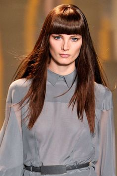 Are you looking for a change but don't want to cut your locks. The answer is Heavy bangs!   This look can update long hair and change face shape.   inspiration for @sebastianprofessional
