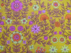 This bright and beautiful floral fabric was produced by John Lewis for their Jonelle brand, and features an Arts and Crafts inspired design of flowers and leaves in a bold palette of yellow, pink and orange.  It is a lovely mid-to-heavy weight cotton suitable for all kinds of craft projects.  It is in great vintage condition with no marks, holes or fading.There are 4 fat quarters available each measuring 57cm wide by 50cm long, if more than one is ordered they will be sent a...