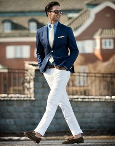Navy jacket blazer sport coat. Blue shirt. White pants. Smart casual.