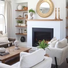We turned back the clock on this flip house to give it a second chance. It's cozy and traditional, with hits of modern.  #neutral #livingroommakeover #traditional #fireplace #white #livingroomdecor Traditional Fireplace, Fixer Upper, Living Room Decor, Neutral, Clock, Homes, Modern, Drawing Room Decoration, Watch