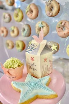 Take a look at this gorgeous under the sea birthday party! The cookies and cupcakes are so sweet! See more party ideas and share yours at CatchMyParty.com  #catchmyparty #partyideas #donutparty #donuts #undertheseaparty #mermaids #cookies #cupcakes #mermaidparty #girlbirthdayparty Girl Birthday, Birthday Parties, Sea Cakes, Mermaid Cakes, Donut Party, Mermaid Parties, Under The Sea Party, Favors, Cupcakes