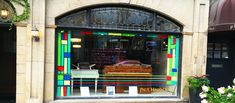 Two pianos from the Art Deco period, framed by a border inspired by Frank Lloyd Wright! Art Deco Period, Frank Lloyd Wright, Store Fronts, Windows, Inspired, Frame, Inspiration, Pianos, Picture Frame