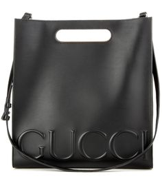 Gucci - XL leather shopper - Gucci puts a signature sophisticated twist on the classic shopper. Redefining the style, this design is crafted from shiny black leather with the house's signature logo embossed in an oversized fashion to the bottom for an instant dose of recognition. We love the clean format and angular edges, toting ours by the handles or slinging it over our shoulder for the height of daytime chic. seen @ www.mytheresa.com
