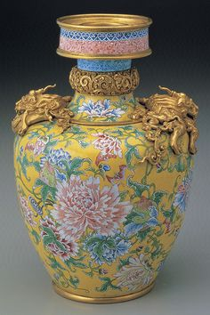 Metal vase with peony flowers and coiled dragons in painted enamels, with the mark and reign period of Emperor Yongzheng, Qing Dynasty, 1723-1735 AD.